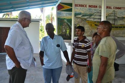 Minister Holder engaging farmers