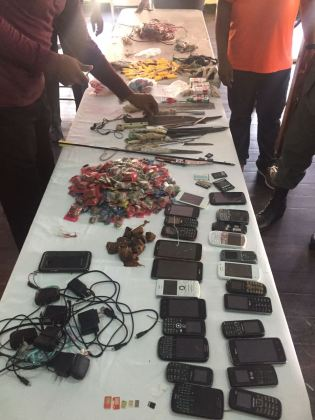 Knives, improvised weapons and cellular phones were among the items Joint Services Officers found during operation Safe Guard at the Georgetown Prison, this morning