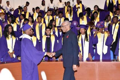 President David Granger congratulates the Class of 2016 Valedictorian of the President's College, Mr. Camroul Hookumchand.