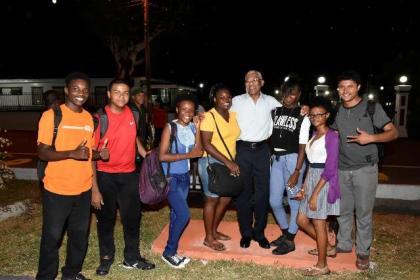 On his way home to State House, President David Granger encountered these students on Main Street, who were delighted to share a photo moment with him.