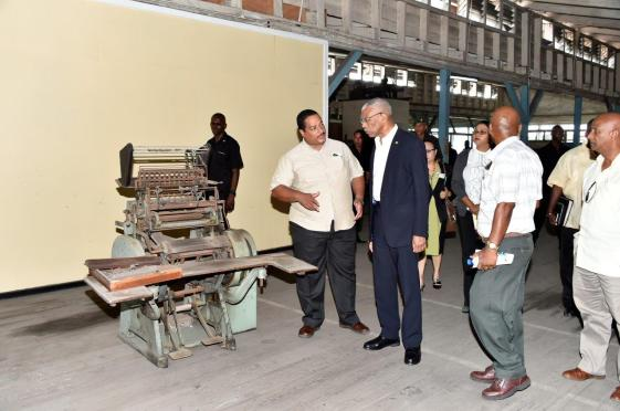 President David Granger taking a look at one of the old machines that is no longer in use