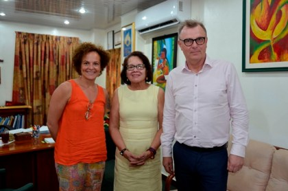 First Lady, Mrs. Sandra Granger, Ms. Ana Landa (left) and Mr. Marko Lehto (right), today, at the Office of the First Lady at State House