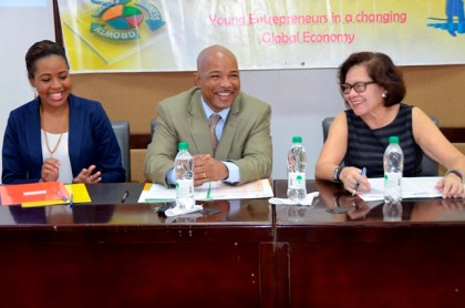 First Lady, Mrs. Sandra Granger shares a light moment with (from left), Ms. Valerie Grant, Founder/Managing Director GeoTechVision Mr. Andrew Boyle, Director of Eureka Laboratory at the workshop.