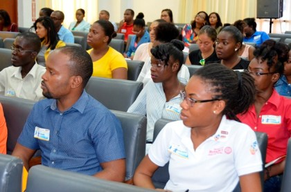 Participants at the Rotaract Club of Georgetown Central's 'The CEO in You: Young entrepreneurs in a changing global economy 2016' workshop pay keen attention as First Lady, Mrs. Sandra Granger delivers her charge.
