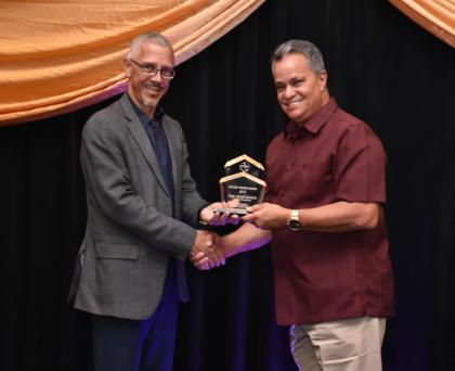 Captain Jerry Gouveia receives the award from Minister of Business with responsibility for Tourism, Dominic Gaskin for Tourism Entrepreneur of the year.