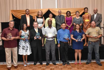 In front row are the awardees; also in photograph are Minister of Business with responsibility for Tourism, Dominic Gaskin (fourth from left), Minister of Public Telecommunications, Catherin Hughes (fifth from left), President of THAG, Andera de Caires (third from left) and Director of Guyana Tourism Authority, Indranauth Haralsingh