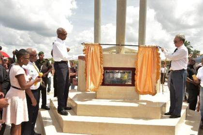 President David Granger and Chinese Ambassador, Mr. Zhang Limin unveiling the plaque to officially commission the arch, which is located at the intersection of Washerpond Road and Causarina Drive