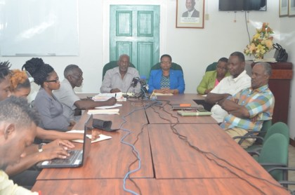 Minister of Social Protection Volda Lawrence and Minister within the Ministry, Keith Scott, along with staff of the Ministry and representatives of Guyana Bauxite and General Workers Union