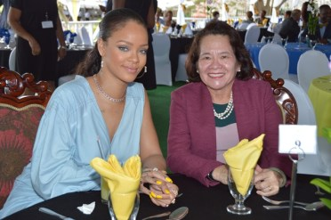 First Lady Mrs. Sandra Granger poses with pop star, Ms. Robin Rihanna Fenty at the Toast to the Nation event.