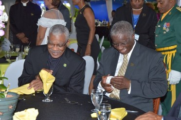 President David Granger and Prime Minister Freundel Stuart sharing a light moment at the Toast to the Nation event