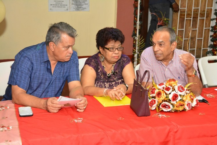 Captain Gerry Gouveia, CEO of Roraima Airways, Minister of Social Cohesion, Ms. Amna Ally, and Chairman of the Salvation Army's Advisory Board, Mr. Edward Boyer during brief discussions before the start of the programme