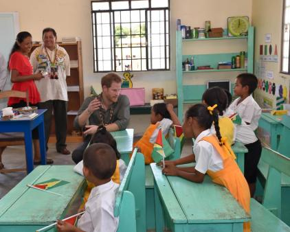 Prince Harry interacts with children at the Surama Primary School