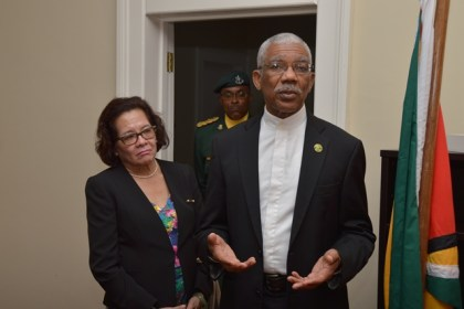 President David Granger addressing the staff of Guyana's Consulate in Barbados as First Lady. Mrs. Sandra Granger listens intently
