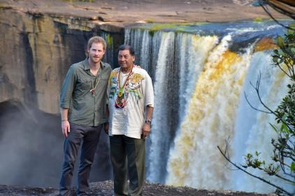 Prince Harry, and Minister of Indigenous Peoples' Affairs, Sydney Allicock, share a light moment at the Kaieteur Falls.