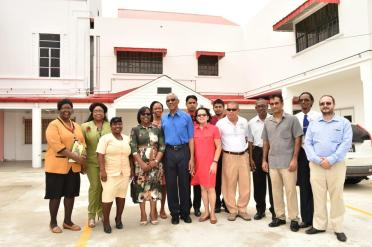 President David Granger and First Lady Mrs. Sandra Granger with staff of the maternity ward at the Georgetown Public Hospital Corporation (GPHC). Minister of Health, Dr. George Norton is standing next to the First Lady, while Minister within the Ministry of Health, Dr. Karen Cummings is on the President's right
