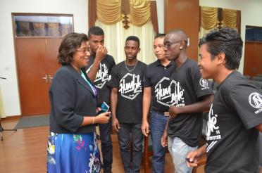 Minister of Public Telecommunications Catherine Hughes and Team Code Ops interacting at the Launch of the Hackthon