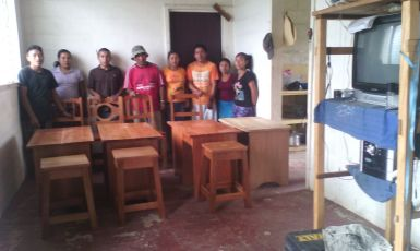 Hinterland youths with furniture they crafted whilst participating in Hinterland Employment Youth and Services Programme