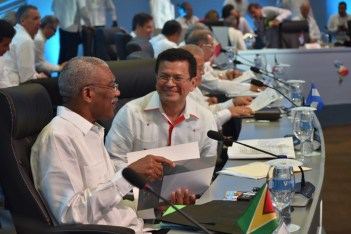 President David Granger and El Salvadoran Foreign Minister Hugo Martinez in discussion during a break of the Fifth Summit of Heads of State and Government of the Community of Latin American and Caribbean States (CELAC).