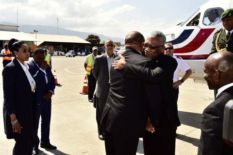 President David Granger is warmly greeted by Haiti's Minister of Foreign Affairs, Mr. Pierrot Delienne upon his arrival in Antigua and Barbuda where he stopped over on his way to Haiti. The President is visiting Haiti for the Inauguration ceremony of the President elect, Mr. Jovenel Moise in his capacity as Chairman of the Caribbean Community (CARICOM) and Head of State of Guyana
