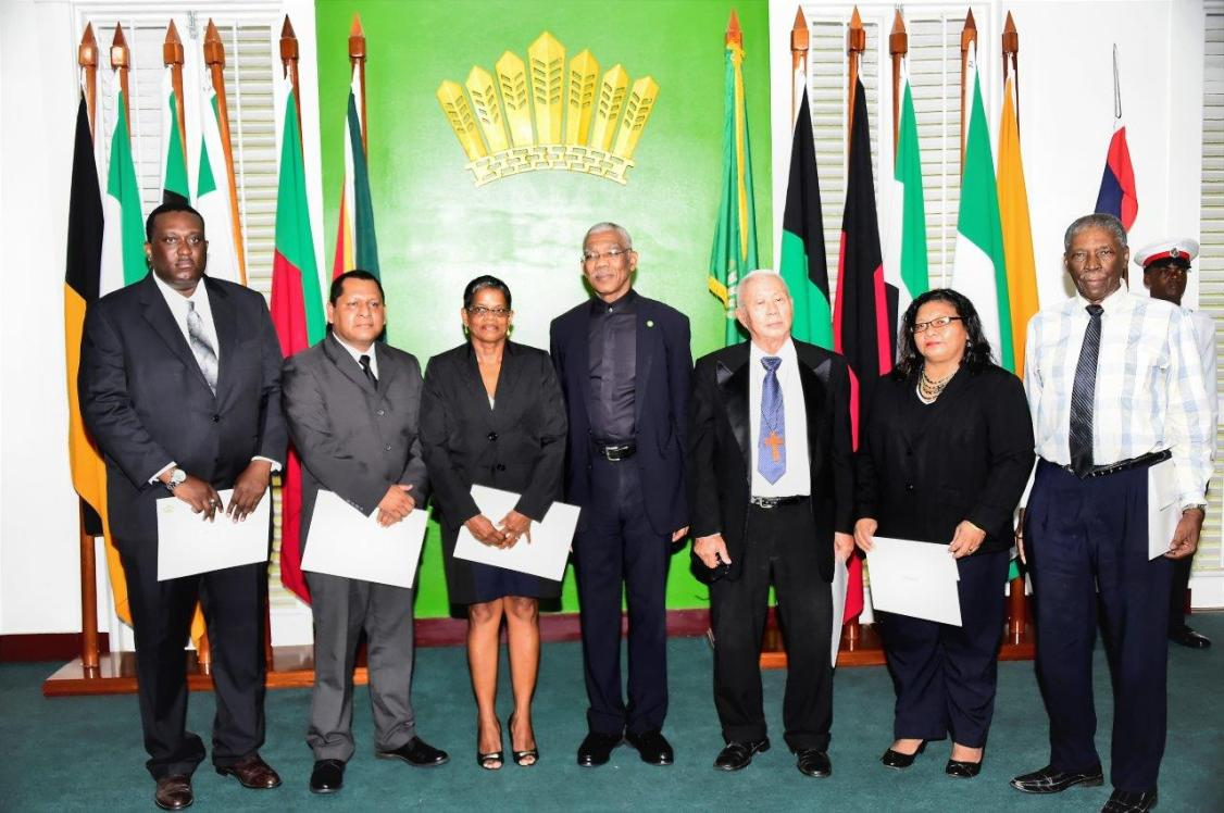 From left: Mr. Lennox Caleb, Mr. David James, Ms. Carol Khan-James, President David Granger, Rev. George Chuck-A-Sang, Ms. Belinda Persaud and Professor Rudolph James after the swearing-in ceremony