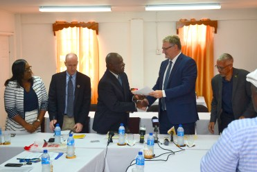 Minister of Citizenship, Mr. Winston Felix receives the Policy Recommendations and Guidelines for Setup of an Electronic Visa (E-Visa) and Work Visa System from Ambassador to the European Union (EU) in Guyana, Mr. Jernej Videtic