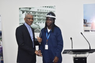 President David Granger receives a token from a staff of one of the industrial sites, which he visited in Freeport, Bahamas