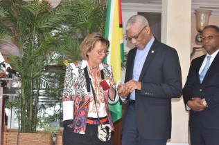 President David Granger receiving a token from a staff of the Grand Bahama Shipyard, where he visited