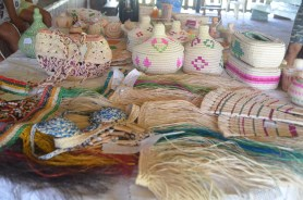 Women of Moraikobai bring their craft out to be sold to members of the Wet Savannah Drive convoy