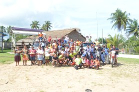 Residents of Moraikobai and members of the convoy for the first official Wet Savannah Drive pose for a picture