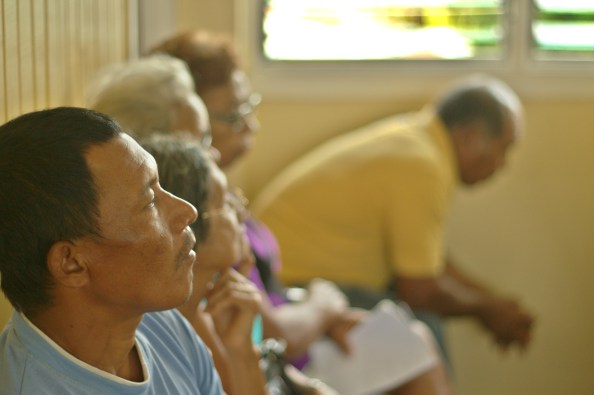 A residents listens closely during a recent meeting with Minister of Public Infrastructure, David Patterson, and Minister of Indigenous Peoples' Affairs, Sydney Allicock in Moruca, Region 1