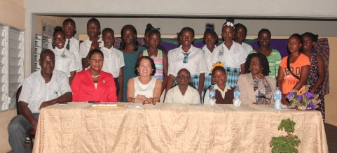 First Lady, Mrs. Sandra Granger, poses with some of the students that are expected to benefit from the ICT training programme