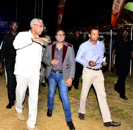 Let us work together! President David Granger, President of the Region Five Chamber of Industry and Commerce, Mr. Imran Saccoor and Regional Chairman, Mr. Vickchand Ramphal heading out to tour the booths at the exposition and trade fair