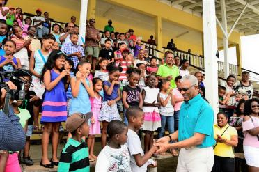 President David Granger greeting these children who were present at the Bartica Community Centre Ground to receive their kites