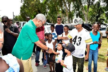 President David Granger shakes hands with this brave youngster