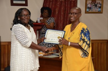 Member of Parliament, Ms. Jennifer Wade presenting Ms. Mabelene McDonald with her certificate of participation