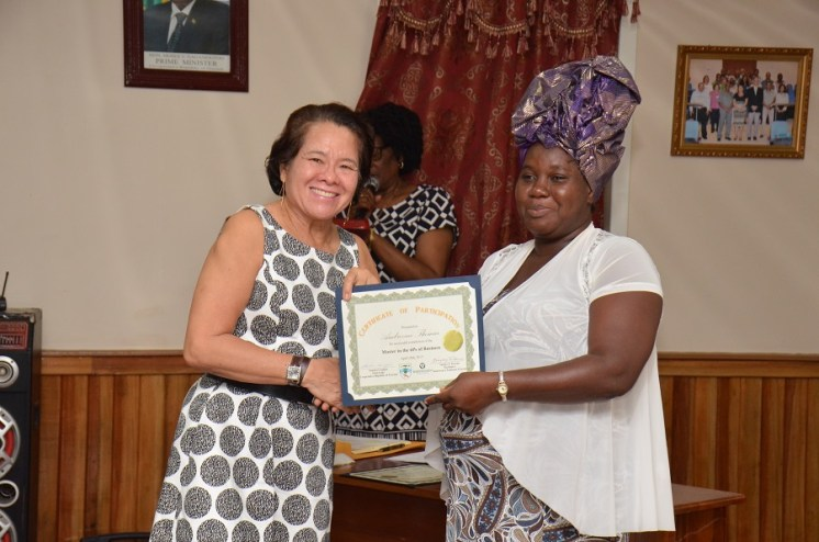 First Lady, Mrs. Sandra Granger presents Ms. Ambrozine Thomas with a certificate of participation, after having successfully completed her Self-Reliance and Success in Business workshop
