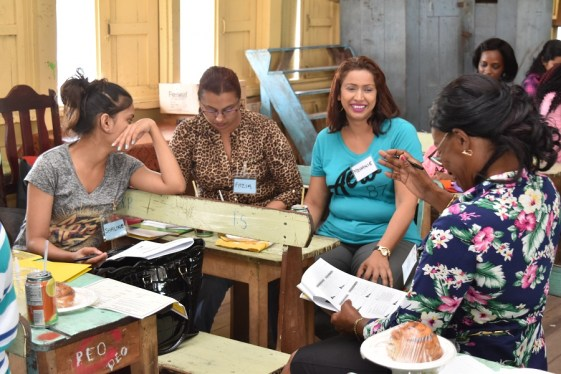 These participants share a light moment during one of the interactive sessions of the workshop