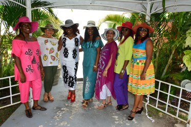 Local designer Ms. Andrea Braithwaite and her models display their elegant Easter hats and attire at the WAD Easter Hat Show and Brunch
