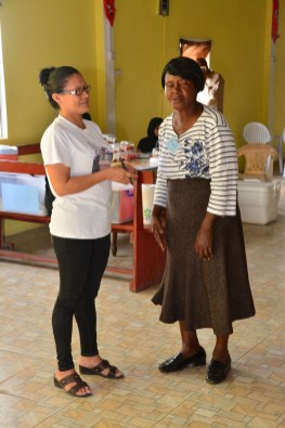 Ms. Vernadine Rodrigues-Ragubeer (first left) and Ms. Pearl Younge interact during one of the trust building exercises