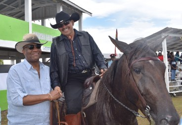 Minister of State, Mr. Joseph Harmon and Vice President and Minister of Indigenous Peoples' Affairs, Mr. Sydney Allicock, sharing a light moment at the Rupununi Rodeo