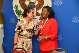 First Lady, Mrs. Sandra Granger expresses her gratitude to Ms. Jacquelyn Shipe, after she presented her with a token of appreciation at the conference
