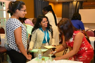 Participants at the YLAI Women's Conference interacting during one of their 'icebreaker' exercises
