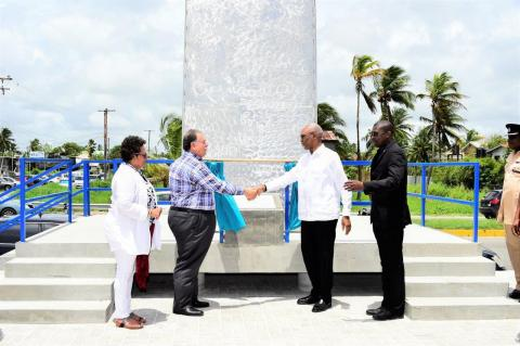 A gift from Ansa McAl to Guyana! Mr. Norman Sabga shakes hands with President David Granger as he formally hands over the arch to the Government and People of Guyana, while Minister of Public Infrastructure, Mr. David Patterson and Ansa McAl's Country Manager, Ms. Beverley Harper look on