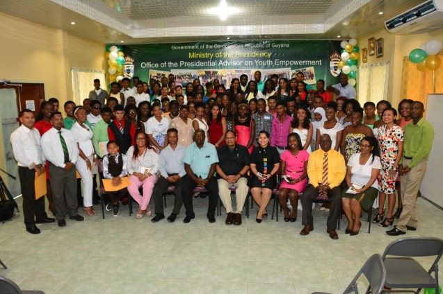 Prime Minister Moses Nagamootoo and Presidential Advisor on Youth Empowerment, Mr. Aubrey Norton and other facilitators pose with the 88 graduates of the Youth Leadership Training Course