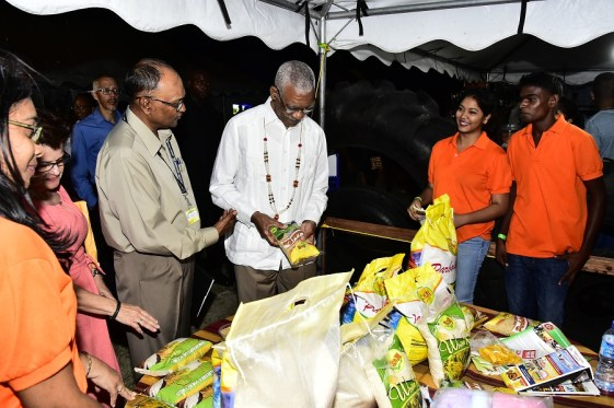 President David Granger takes a closer look at some of the products on sale and displayed at the Essequibo Agro and Trade Expo, along with President of the Essequibo Chamber of Commerce, Mr. Deleep Singh