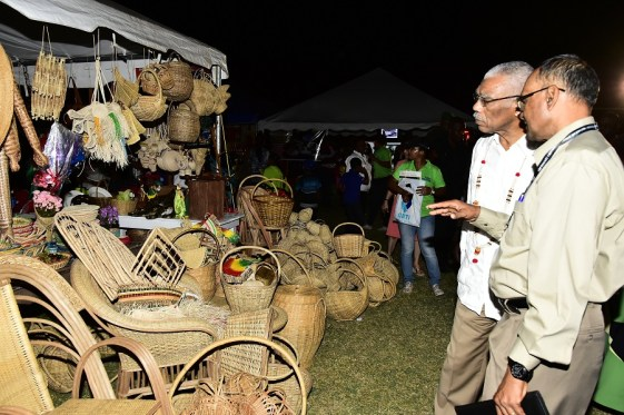 President of the Essequibo Chamber of Commerce, Mr. Deleep Singh discussing craft work on display at the Essequibo Agro and Trade Expo with President David Granger, who declared the event open