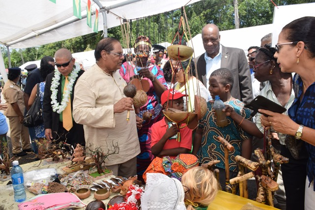 Acting President, Prime Minister Moses Nagamootoo checking out Berbice's rich drumming culture.