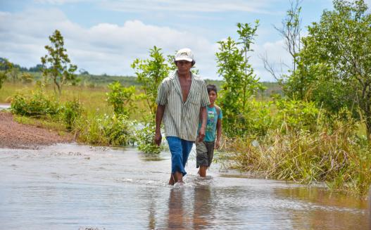 A father and son heading to check on their fish traps