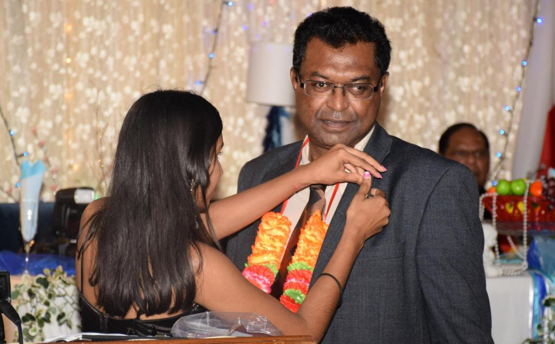 Minister of Public Security, Khemraj Ramjattan bing awarded with his honorary button by his alma mater at the J.C Chandisingh 21 years of alumni in Corentyne, Berbice