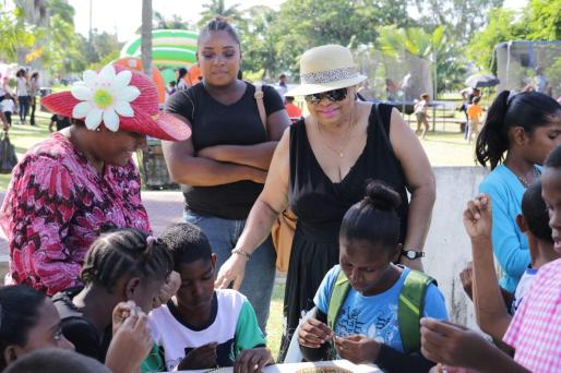 Minister of Social Protection Amna Ally observing some of the children involved in activities at the Family Fun Day at the Botanical Gardens
